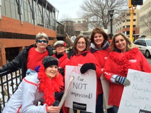 Nurses from River Falls show up to picket with other Allina nurses at United Hospital.  Bridget Nelson (kneeling), Kathy Bloom, Lori Morris, Ashley Greengard, Julie Schommer, Amy Hauenstein